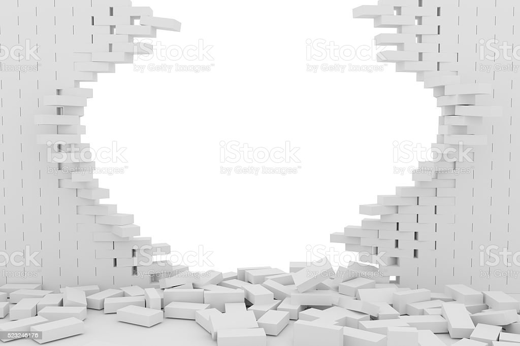 Destruction of a white brick wall on white background stock photo