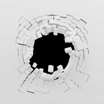 Destruction of a white wall isolated