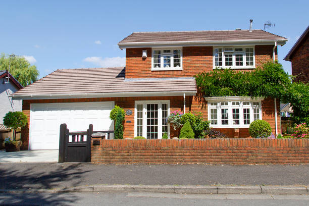 Detached four bedroom red brick house. stock photo