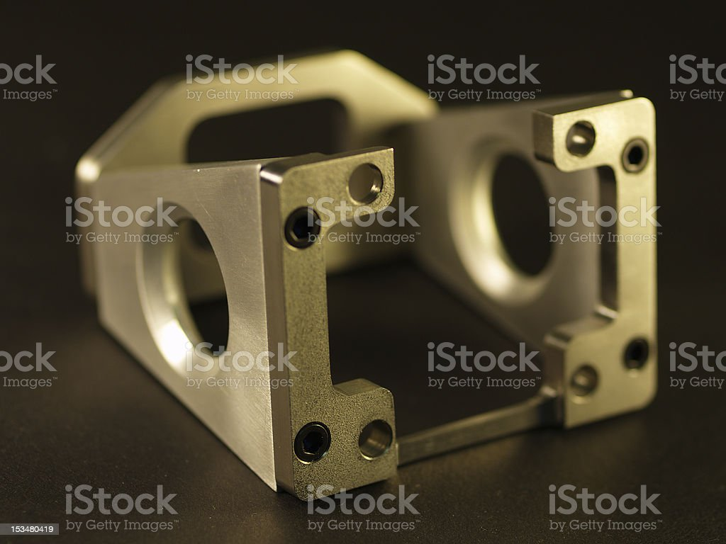 Detail Aluminum Machining This is a picture of a custom milled or machined part.  Machine shops use manufacture these types of custom parts with CNC machines, lathes, mills and turning centers. Accuracy Stock Photo