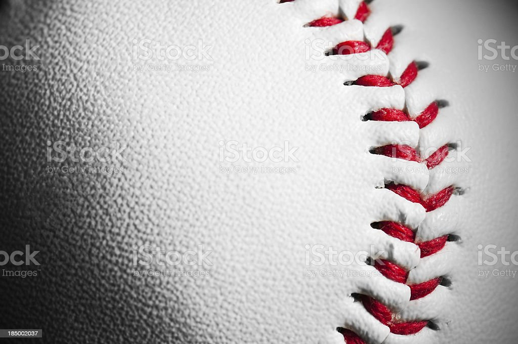 Detail and texture of white leather baseball with red stitching stock photo