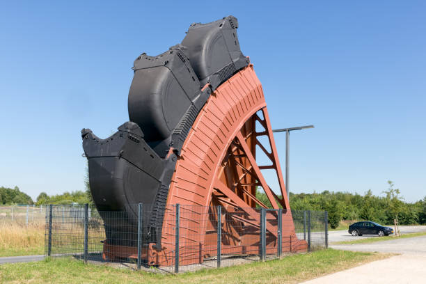 Detail bucket wheel digging excavator open pit coal mines Germany Hambach lignite mine, Germanu June 28, 2018: Exposition of bucket wheel at original size from digging excavator in open pit coal mines in Germany tagebau stock pictures, royalty-free photos & images