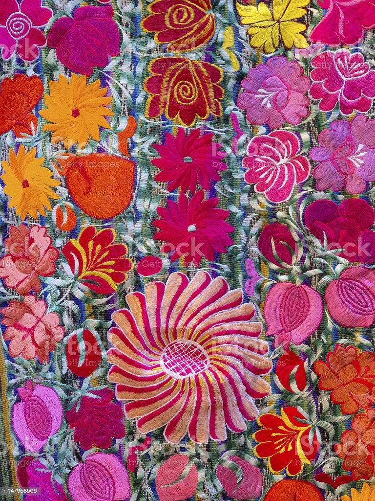detail embroidery of colorful flowers stock photo