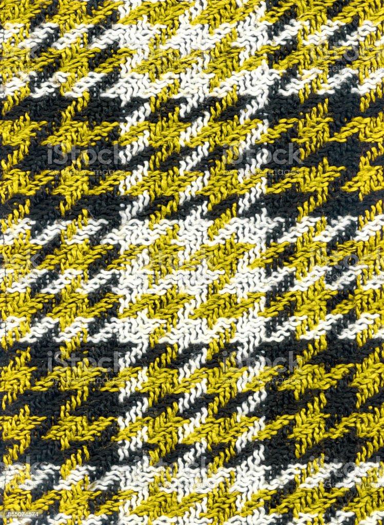 Detail flat yellow black white checkered houndstooth woolen skirt stock photo