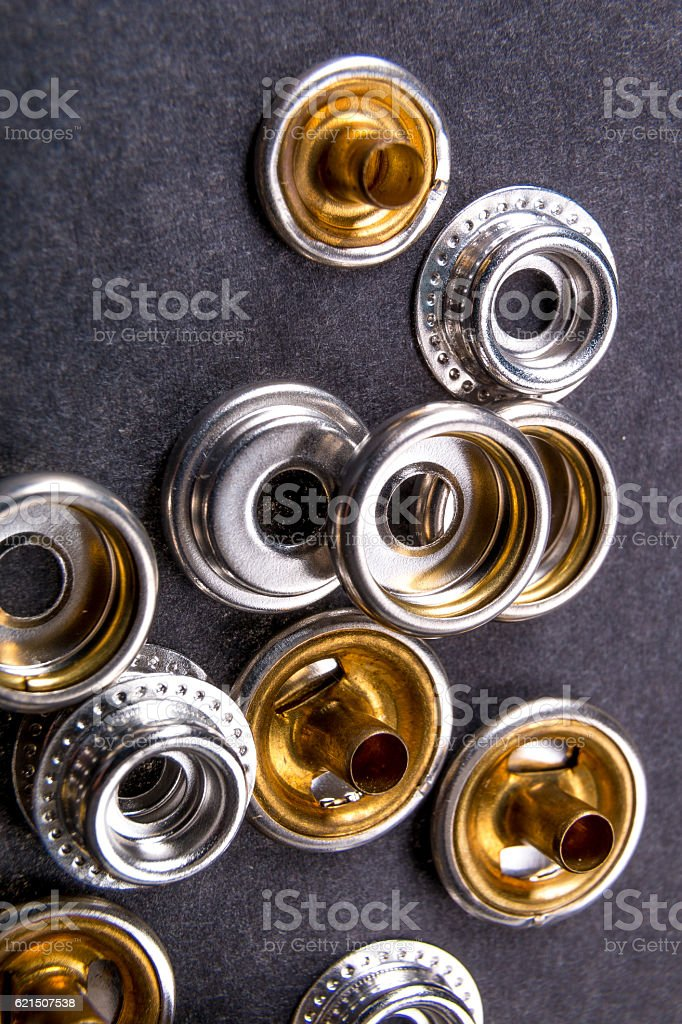 Detail for metal buttons  clothing on black background. Close up. foto stock royalty-free