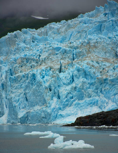 Detail for the ice wall of the Aialik glacier. Melting of glaciers. Global warming. Landscape, seascape, portrait, fine art. In the Kenai Fjords National Park (Seward), Alaska . July 28, 2018 stock photo