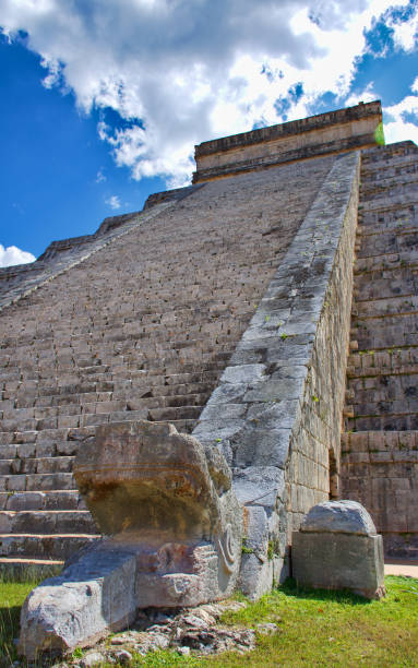 Detail for the serpent's head at the base of the stair, with its body and tail going to the top. Nobody. El Castillo (The Kukulkan Temple) of Chichen Itza, mayan pyramid: Yucatan, Mexico - Mar 2, 2018 stock photo