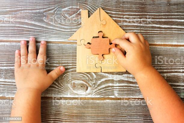 Detail from a wooden house from puzzles in the hands of a child on a picture id1153689093?b=1&k=6&m=1153689093&s=612x612&h=gw3emsni4fqwrnpk8pm8ack4 lwwvyxskwgr6t7xqgk=