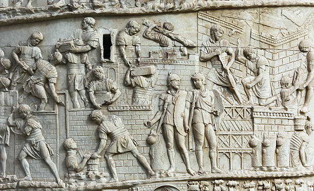 Detail from Trajan's Column in Rome Detail from Trajan's Column representing roman soldiers building a defensive wall. ancient rome stock pictures, royalty-free photos & images