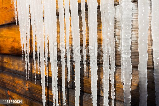 icicles in front of vintage wood frozen winter cold ice icicle series