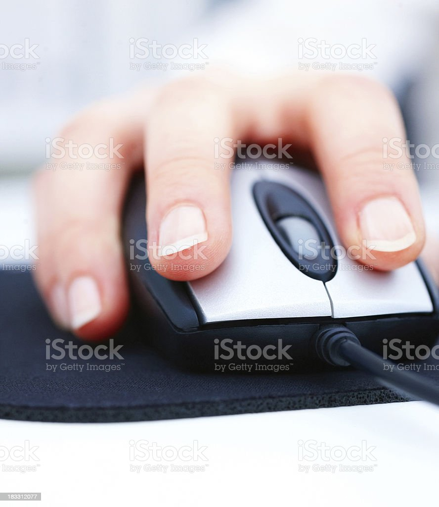 Detail image of a young girl using computer mouse royalty-free stock photo