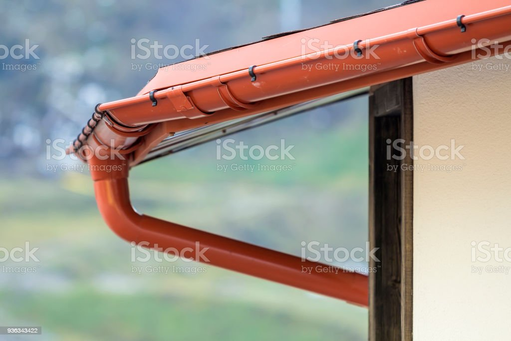 Detail image of new roof with gutter rain system stock photo