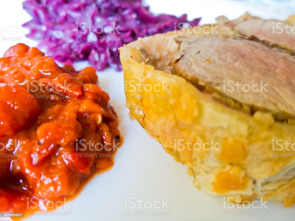 Detail of a beef Wellington slice with sweet red cabbage and ajvar stock photo