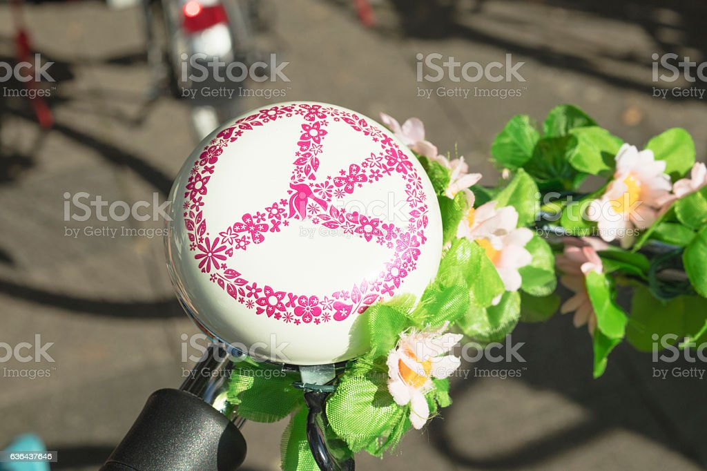 Detail of a bicycle's ring bell with sign of 'Peace' stock photo
