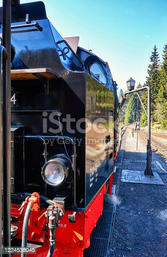 istock Detail of a black steam locomotive at the train station. 1224538045