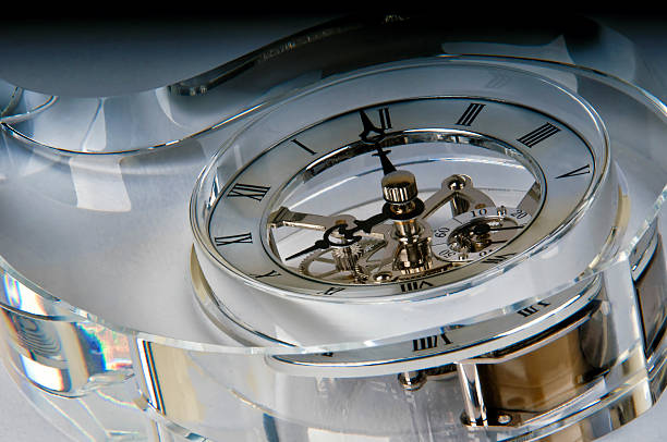 Detail of a clock in a glass block stock photo