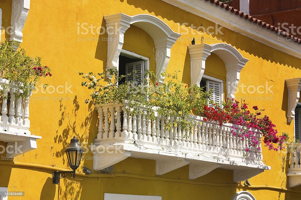 Detail of a colonial house. balcony with flowers and plants royalty-free stock photo