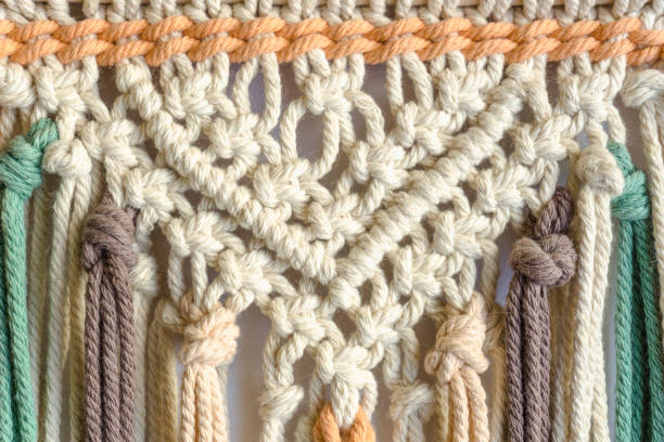 Detail of a colourful macrame threads. Boho style. Close up view. stock photo