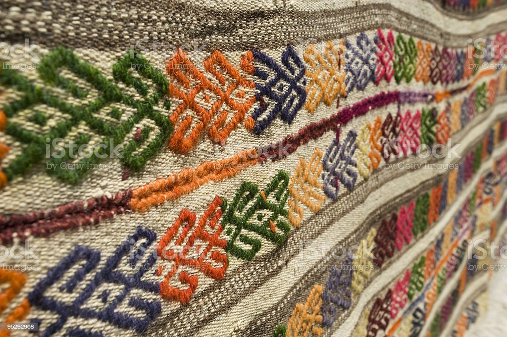 Detail of a decorated wool carpet royalty-free stock photo