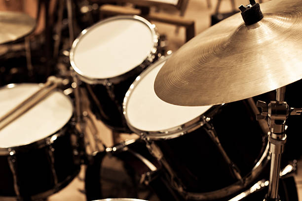 Detail of a drum kit Detail of a drum kit in dark colors drum kit stock pictures, royalty-free photos & images