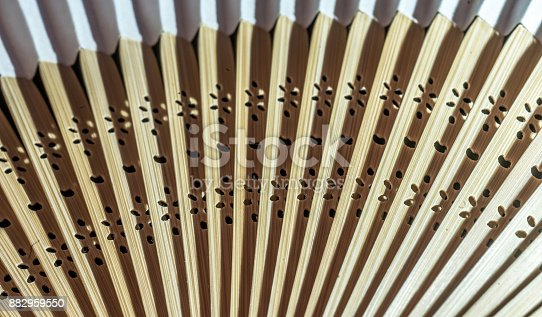 istock Detail of a fan made of bamboo and paper 882959550