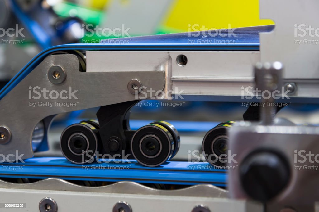 detail of a folder gluer machine stock photo