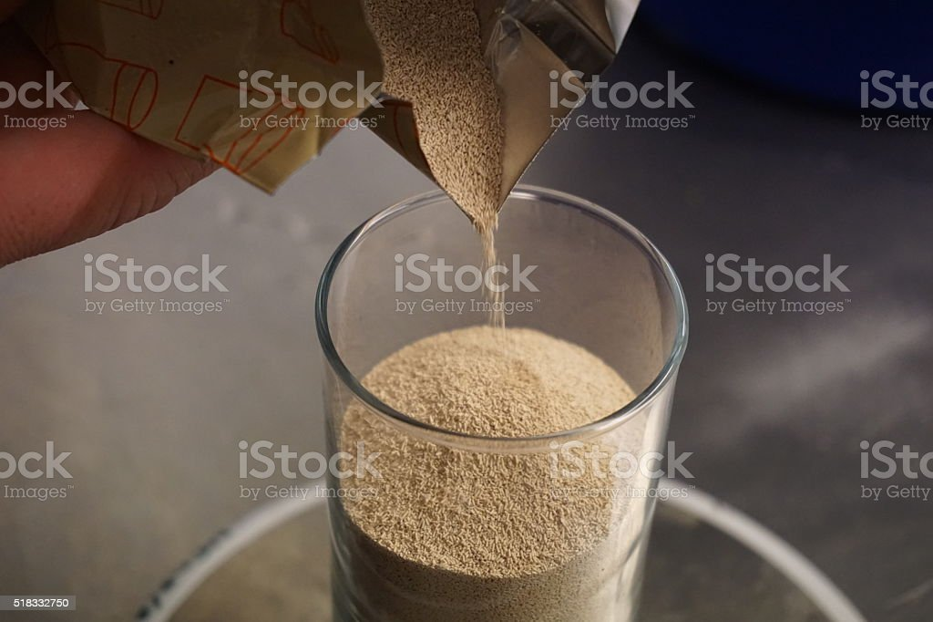Detail of a glass filled with yeast (leaven) stock photo