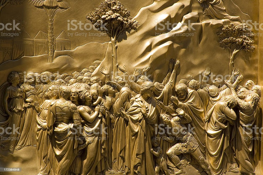 Detail of a golden church gate in Florence royalty-free stock photo