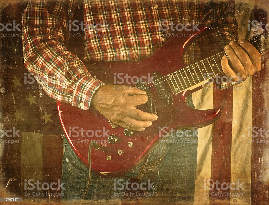detail of a guy playing the guitar stock photo