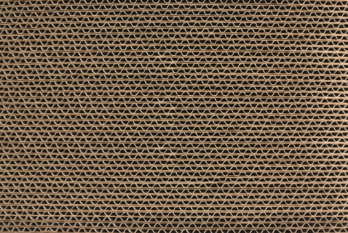 Detail of a stack of corrugated brown cardboard