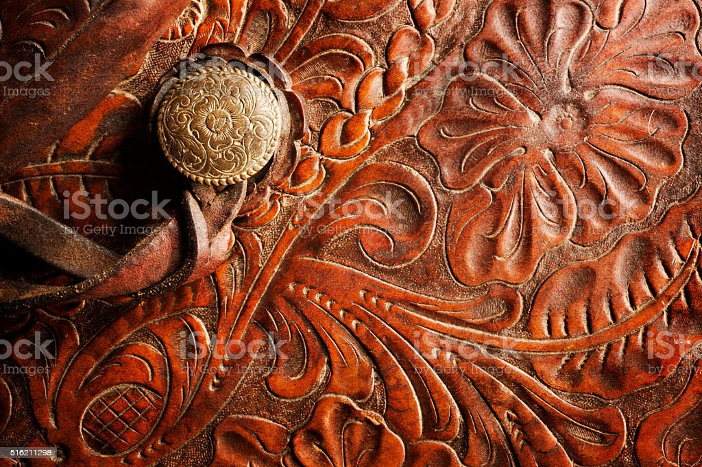 Detail Of A Leather Horse Saddle Tooled With Filigree Design stock photo