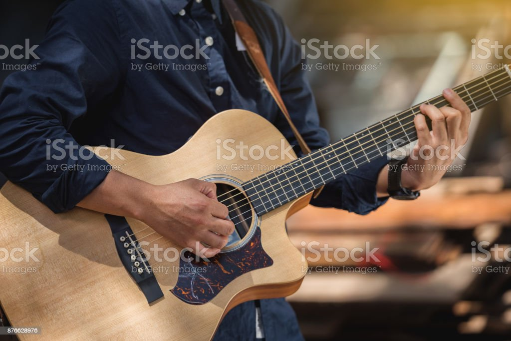 Detail of a man playing guitar stock photo