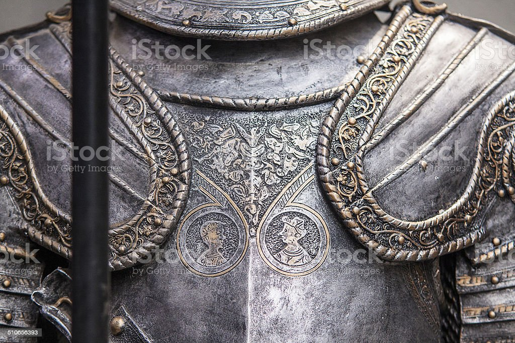 Detail of a medieval knight armor with sword stock photo
