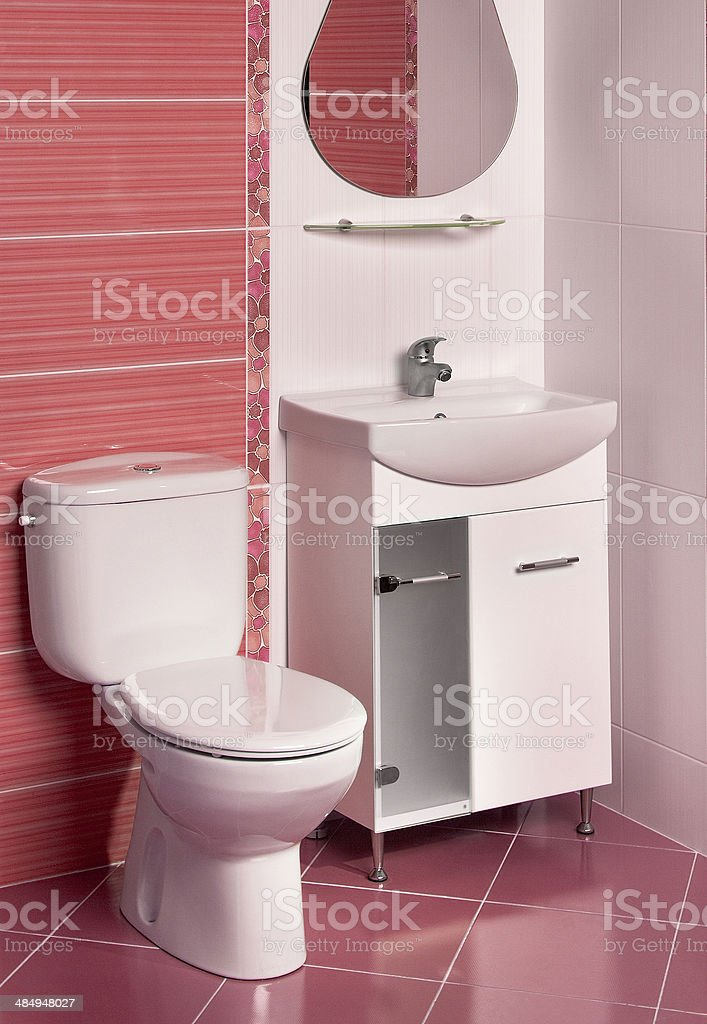 detail of a modern bathroom interior in red and white stock photo