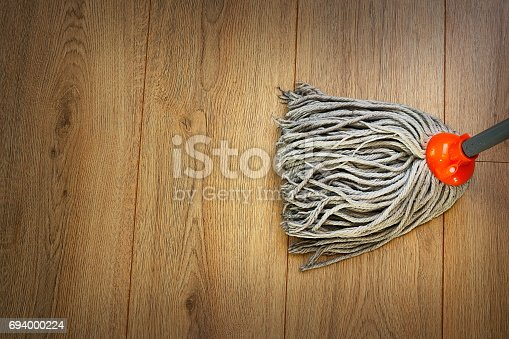 istock detail of a mop on wooden parquet 694000224
