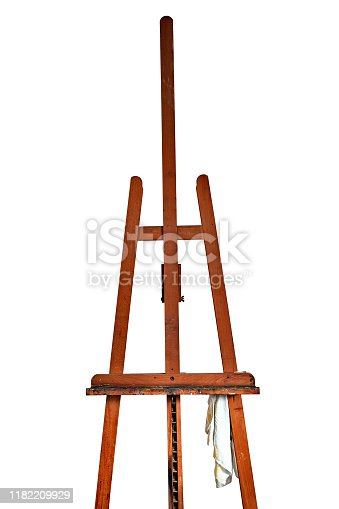 671393252 istock photo Detail of a Painter's easel isolated on white 1182209929