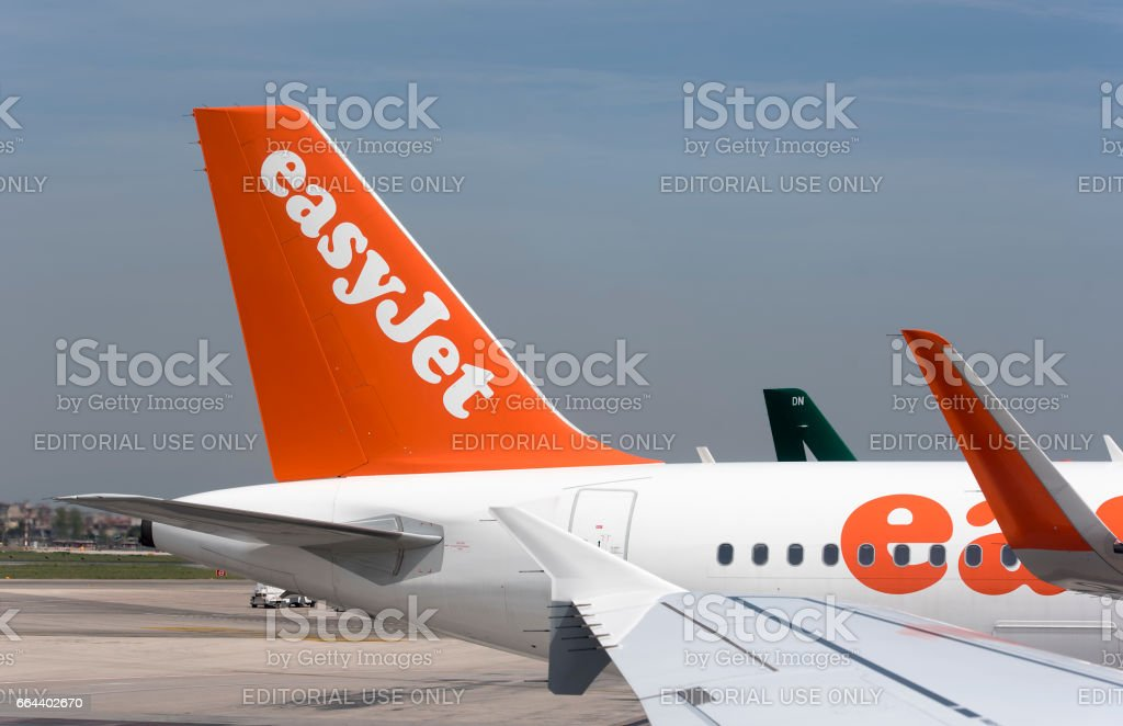 Detail of a plane A319 by EasyJet airplane in Naples Airport in Italy stock photo