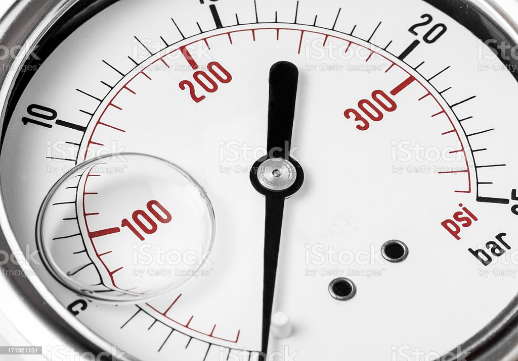 A detail of a red, black, and white pressure gauge on zero. stock photo