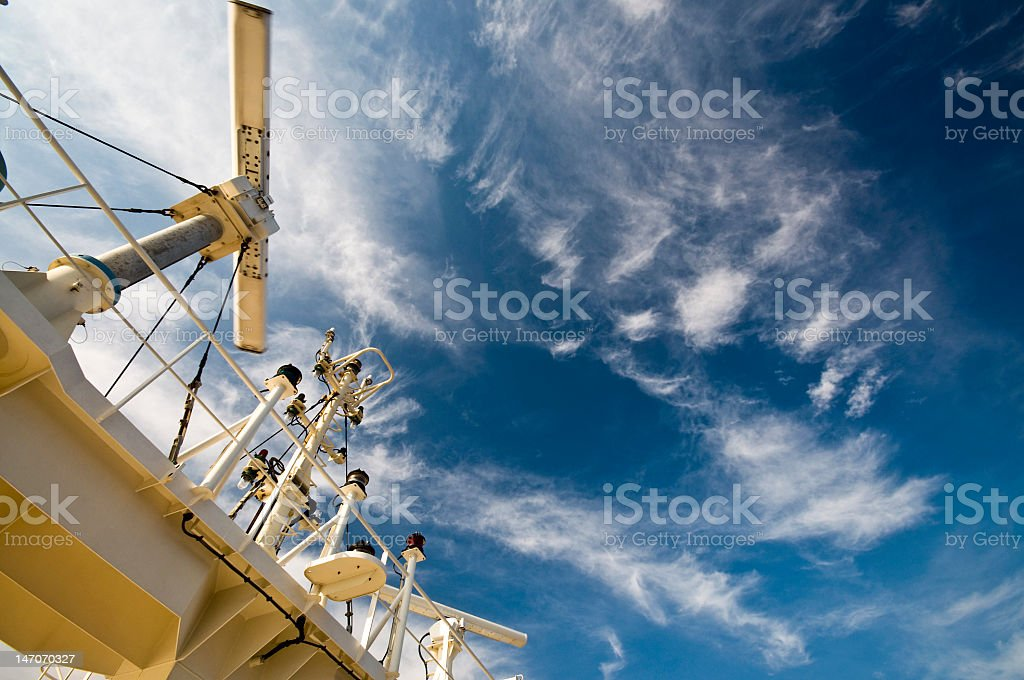 Detail of a ship's navigation equipment under cloudy sky stock photo