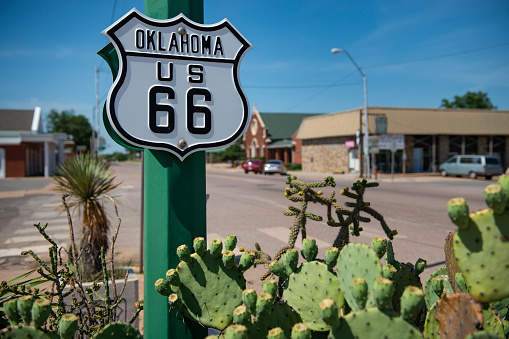 Detail of a US route 66 road sign in a town in the State of Oklahoma, USA. Concept for road trip in the USA.