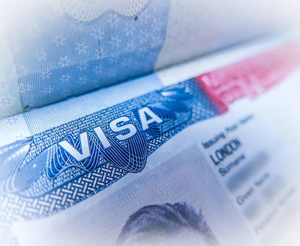 Detail Of A USA Visa Detail Of A United States Of America Work Visa In A UK Passport passport stamp stock pictures, royalty-free photos & images