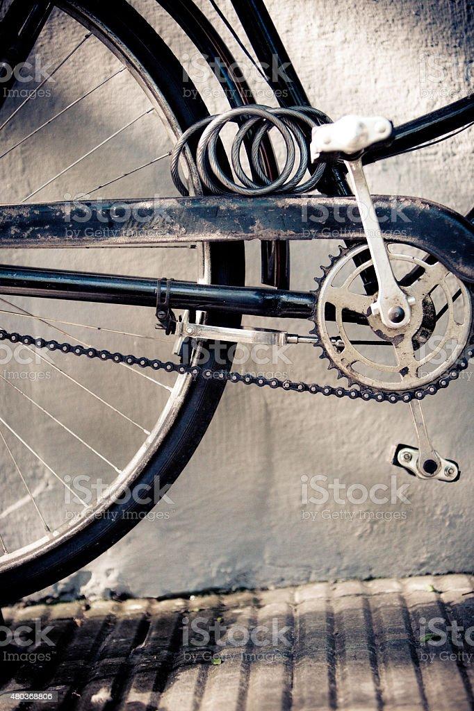 Detalhe do Vintage com bicicleta Crankset corrente e trava - foto de acervo