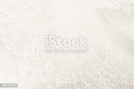 Detail of a wedding dress with decorations perfect for backgrounds.