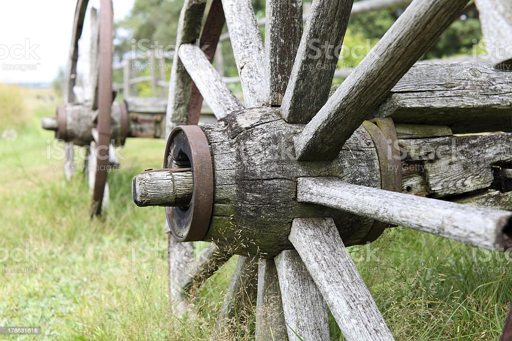 Detail of a wooden wagon wheel. stock photo