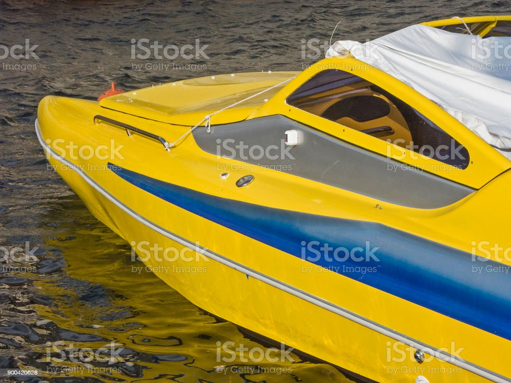 detail of a yellow motorboat stock photo