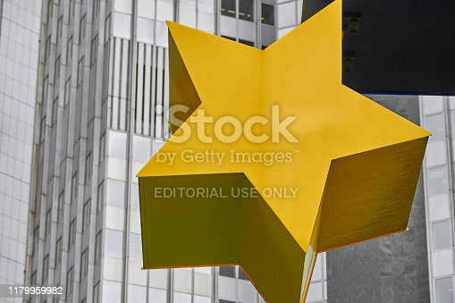 istock Detail of a yellow star of the Euro sculpture in front of the old former building of the European Central Bank (ECB) 1179959982