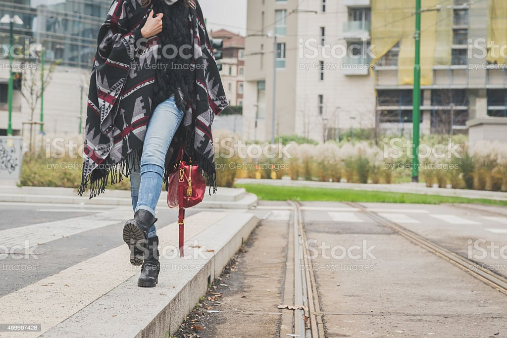 Detail of a young woman posing in the city streets stock photo