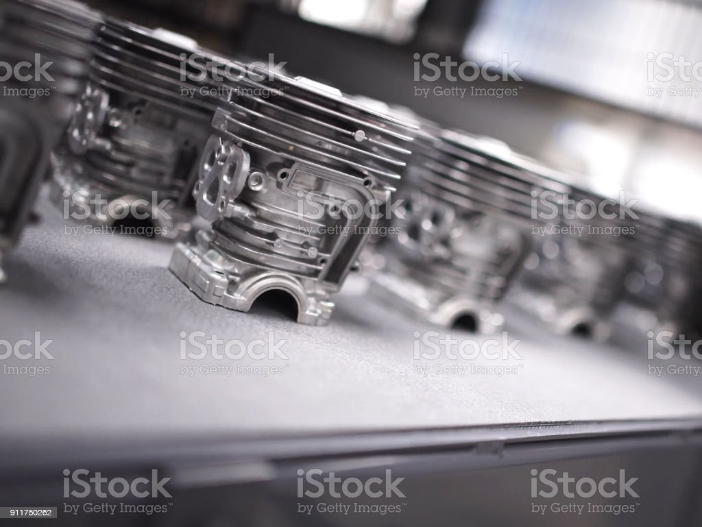 Detail of aluminum castings in a motorcycle engine production line. stock photo