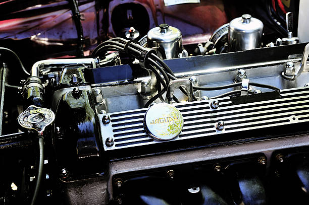 Detail of an engine Jaguar XJ Ales, France - April 11, 2015: Detail of an engine Jaguar XJ photographed vintage car rally Town Hall Square in the town of Ales, in the Gard department  jaguar xj stock pictures, royalty-free photos & images
