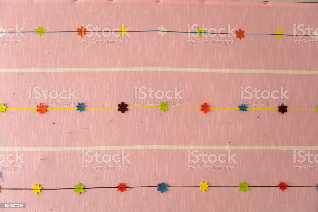 Detail of an grungy cloth panel in refurbishing preschool room royalty-free stock photo